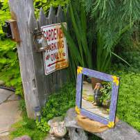 Lisa and Jeff's beautiful garden is a fine location to display her art, such as this mosaic mirror. (Photo by Colleen Miko)
