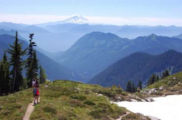 Hiking at Mount Rainier provides spectacular views and wildlife watching opportunities.