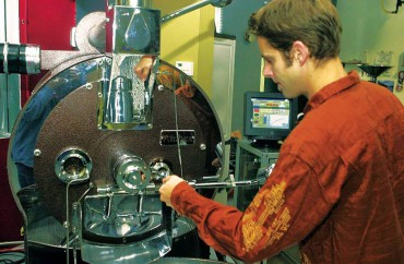 Mike Williams goes about the roasting process at Grounds for Change in Poulsbo.