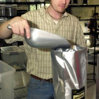 Production manager Greg Shaffer prepares a bag of coffee for shipping.