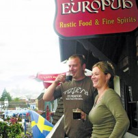 Rob DiFilippo and Tammy Mattson, owners of Poulsbo's Tizzley's EuroPub, enjoy a cup of shade-grown coffee — and the view from the restaurant's balcony.