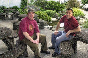 Angus J. McDonald (left) and Scott C. Claflin, co-owners of 12 Trees Cafe & Catering in Poulsbo, serve organic coffee at their location.