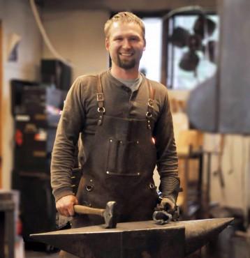 Elijah at home at his anvil.