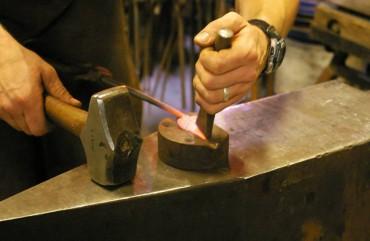 Burnett creates delicate veining on a leaf using a cross-peen hammer.