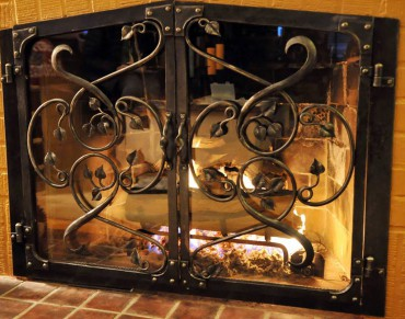 Fireplace screens and doors are a natural place for custom iron work.