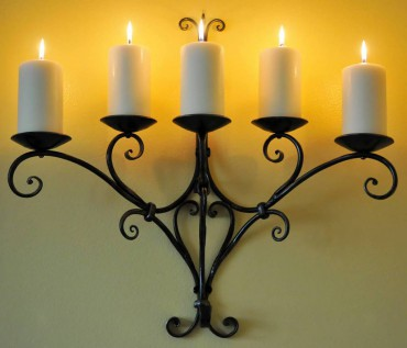 Traditionally styled scroll sconce.