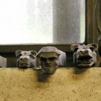 """Series of what Elijah refers to as """"doodles"""" line the windowsill of the shop."""