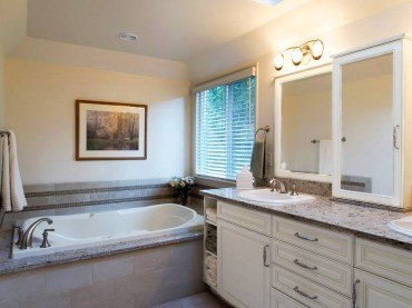 Deck mounted tub by MTI with deck mounted Roman tub filler by Kohler