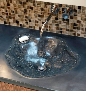 Integral concrete vanity sink with wall-mounted faucet by California Faucets. Design by A Kitchen That Works LLC