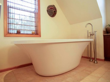 Freestanding tub by Fleurco with Floor mounted Roman tub filler by Cheviott