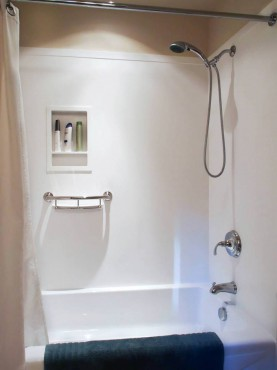 Tub filler with diverted and hand-held shower on a slide bar by Kohler