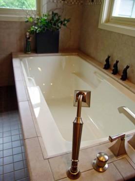 Deck mounted Roman tub filler with diverter and hand-held shower by Kohler