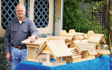 Winston Rader with his recycled wood houses and feeders