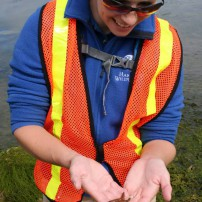 Program Coordinator Rachel Easton shares a tiny mottled sea star.