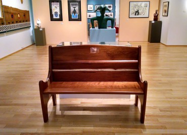 High-back bench of solid ifilele wood at Bainbridge Art Museum.