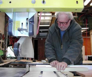 John Steiner in his woodworking shop on South Beach (Rich Passage)