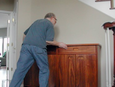 John Steiner delivering an ifilele wood entry hall cabinet