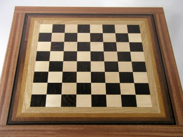 This John Steiner chessboard, made from anigre, mahogany, maple, walnut and wenge, has a slight glow to it. Steiner was trying to capture the color mechanics of iridescence by using gradations of wood color.