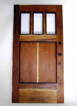 This entry door was made by Steiner from ifelele wood and complemented with the sapwood of the merbau and wenge trim.