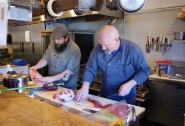 Chef Mike Holbein (left) and Chef Tom Humbock in the heat of Battle Lamb at Gig Harbor's Fight Night.