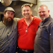 Chef's Holbein and Chef Hummock pose with Chef Ed Lintott a former Fight Night participant