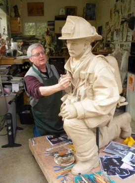 Sculptor John Jewell working on firefighter bronze for 9-11 memorial