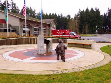 """Reflection Park"" at West Pierce Fire & Rescue headquarters displays Jewell's ""Contemplating Trade Center Steel"" bronze sculpture and a part of the steel beam from the Trade Center."