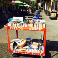 Deals are to be had on the red cart outside Liberty Bay Books in Poulsbo.