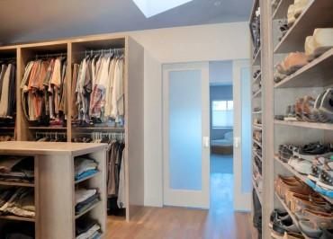 Informal walk-in closet — design by A Kitchen That Works LLC