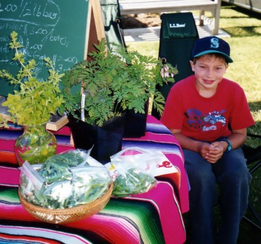 Selling their own grown produce at the farmers market gives kids the chance to share their passion.