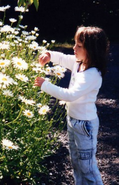 Kids love to explore plants and critters in the garden.