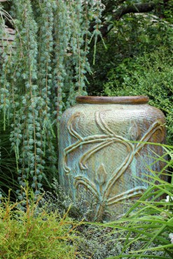Pottery in the garden serves as focal points and enhances the plantings.