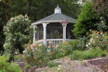 Santica's Perfect Solitude rose garden features a gazebo.