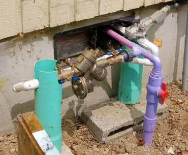 Purple pipe indicates flow of reclaimed rainwater into KCD's office toilet. Backflow prevention device is required, as is permitting for this type of use.