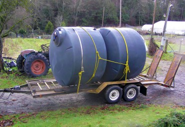 Cisterns arrive at Pheasant Fields Farm for installation. The system was designed by Ken Drexel with the Kitsap Conservation District in 2010.