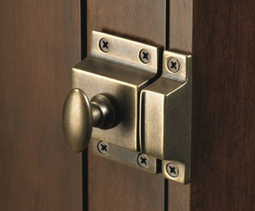 Cabinet latch in German bronze by Top Knobs