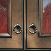 Normandy twisted ring-drop pull in patina rouge by Top Knobs