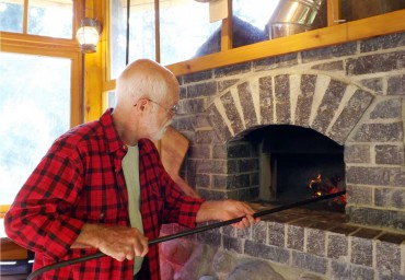 Bob Fortner stokes a warming fire.
