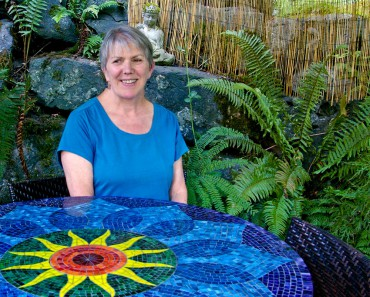 Martin sits at her colorful chakra table.