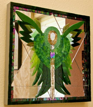 Winged heart chakra represents the warm feelings that come from meditation. The color green represents this energy center.