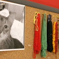 Inspiration board: Tigger the cat, soon to be memorialized in a round, window-hanging portrait and beads
