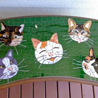 Garden bench commissioned to honor a family's kitties