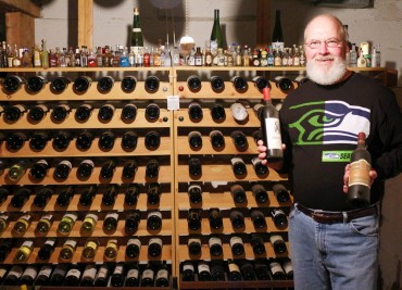 Berger standing in front of his wine cellar