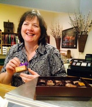 Karen Suther, Boehm's of Poulsbo manager, prepares a gift box for a customer.