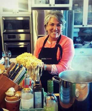 Laureen Lund shows off the club's homemade pasta.