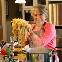 Laureen Lund shows off the club's pasta handiwork.