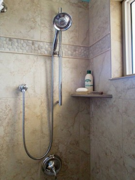 Tile corner shampoo shelf — design by A Kitchen That Works LLC
