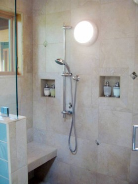 Integrated cantilevered tile shower seat — design by A Kitchen That Works LLC