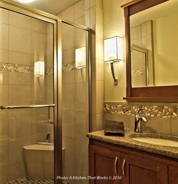Integral solid base tile corner shower seat — design by A Kitchen That Works LLC