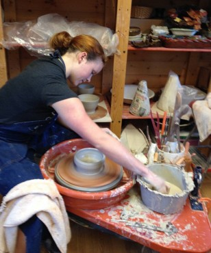 Amy Barkauskas at the potter's wheel
